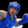 Chungneijang Mary Kom Hmangte (Blue) of India competes against Maroua Rahali (Red) of Tunisia during the Women's Fly (51kg) Boxing Quarterfinals on Day 10 of the London 2012 Olympic Games.