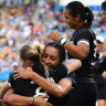 New Zealand players celebrate their extra-time win in the gold medal match of the rugby sevens.